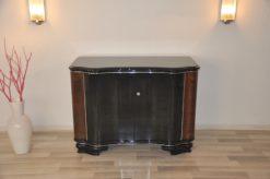 highgloss black, caucasian walnut wood, handpolished, chromebars, 2 big curved swing doors, glassplate