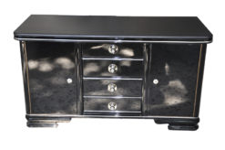 Art Deco Commode, wonderful straight body, curved foot, highloss black , small chromefittings, handpolished, 4 massive drawers, leatherplate