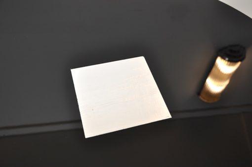 Art Deco Crone Sidetable, Metalapplications on the topplate, rotating chromebars, handpolished, highgloss black