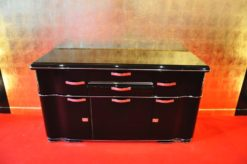 Art Deco Sideboard, unique Design with elegant doorswing, chromed handles and locks, pianolacquer on the outside / mattblack paintjob on the interior