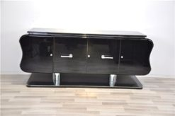 absolute unique furniture - france 1932, curved form - timeless design, big feet with chromed legs,black highgloss paintjob, plenty of storage space