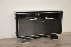 Art Deco Commode, elegant Design with rounded corners, chromelines, big chromehandles, pianolacquer