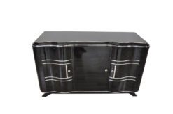 Elegant Art Deco Sideboard, elegant design with curved doors, chromelines and chrome fittings, pianolacquer in highgloss black, handpolished