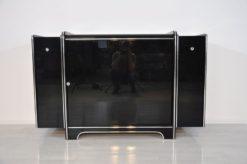 Art Deco Sideboard, highglossblack pianolacquer, fine chromlinies uand chrome handles, glass sliding door