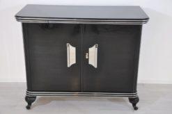 Art Deco Commode, highglossblack pianolacquer,fine chrome details and big chrome handles, clean interior, 1925