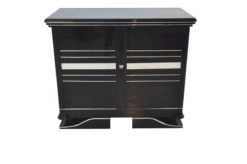 Art Deco Commode, straight forward body language, big chrome applications, wonderful foot, pianolacquer in highglossblack, interior made of cherrywood