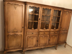 Antique Display Cabinet With Floral Carvings And Decorative Glazing Bars