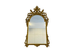 This large, gold-colored wall mirror impresses with its extraordinary carvings. It fits ideally in large corridors and reception halls or, for example, antique-style dining rooms. The mirror has hardly any / only slight signs of wear and is in excellent condition.