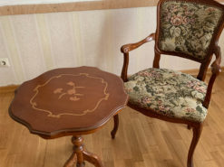 Side Table And Upholstered Armchair